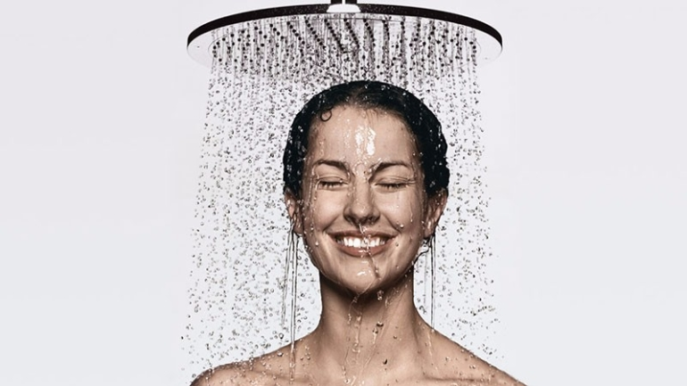 happy woman showering